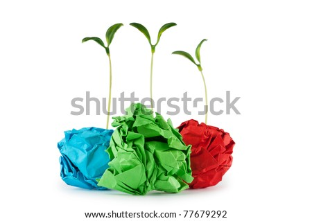 Paper recycling concept with seedlings on white - stock photo