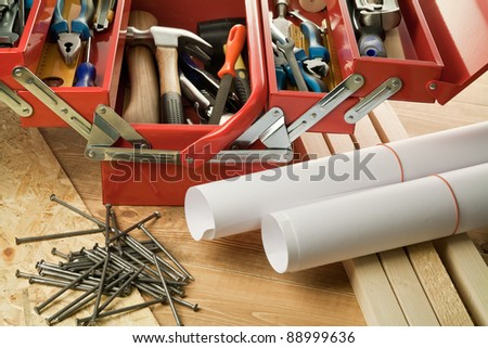 Paper rolls and tool box. - stock photo