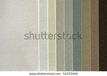 Paper sampler in various colors as background with room for text