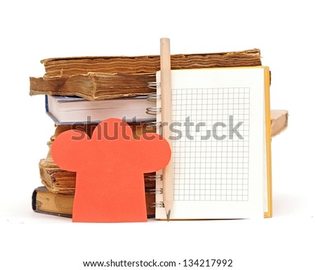 paper shape chef hat on stack books and blank notebook for your recipes, menu... - stock photo