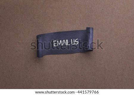 paper sheet with email US text on wooden background