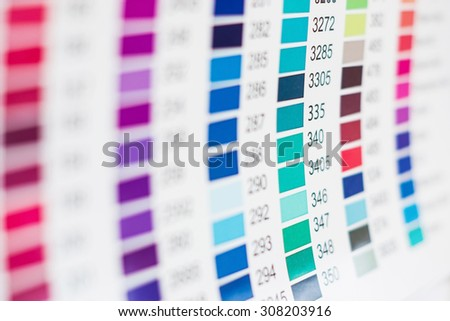 Paper sheet with printed  table of color swatches with their numbers  - stock photo