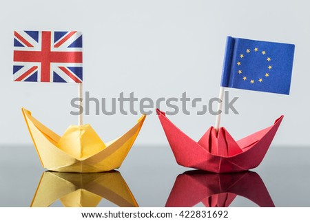 paper ship with british and european flag, concept shipment or free trade agreement and membership of eu, brexit