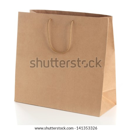 Paper shopping bag with  handles. - stock photo