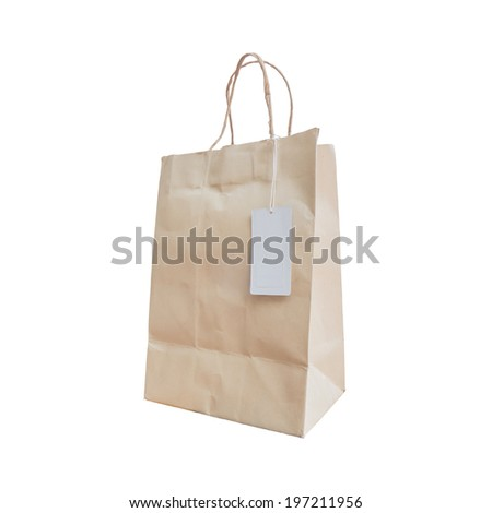paper shopping bag with paper handles and white tag isolated - stock photo