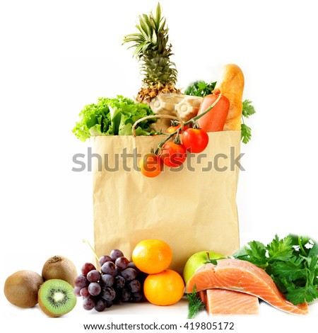 paper shopping bag with vegetables and fruits, berries and food