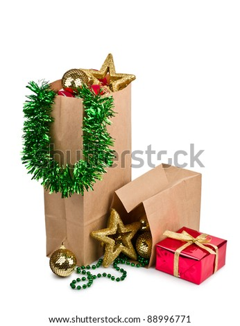 Paper shopping bags christmas decoration with balls and stars isolated on white background - stock photo