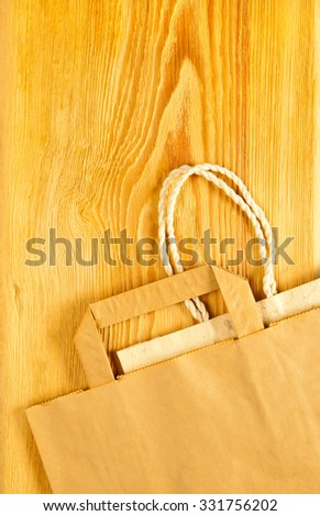 paper shopping bags on a wooden table - stock photo