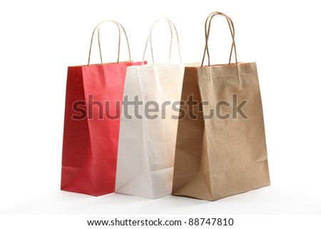 Paper shopping bags on white background.