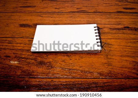 Paper Short Note Book on Wooden Table Rustic Style / write down your text here, background and texture. - stock photo