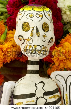 Paper skeleton with flowery background from Mexico day of the day holiday Dia de los Muertos. - stock photo