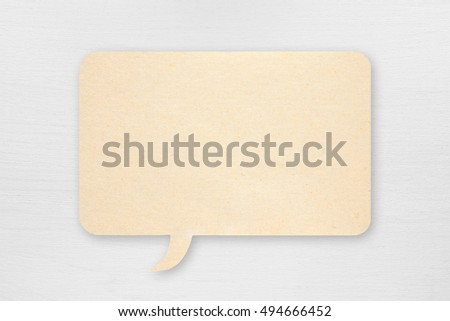 Paper speech bubble on white wooden background