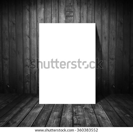 paper stand in black wooden room - stock photo