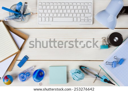 Paper, stationery and keyboard on wooden planks background - stock photo