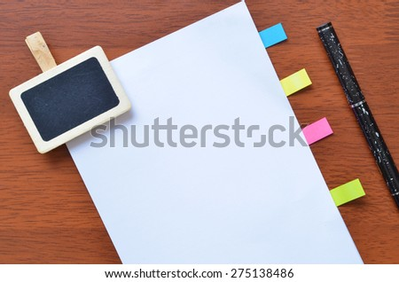 Paper stick marker and sign clip on the white blank paper - stock photo