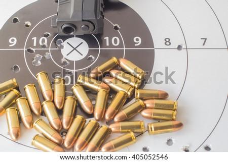 paper target gun pistol magazine and bullet. - stock photo