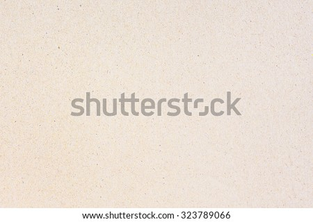 Paper texture light rough textured spotted blank copy space background in beige, yellow, brown - stock photo