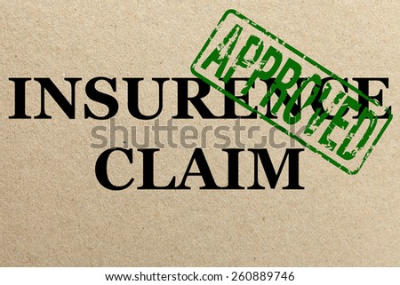 Paper texture with Approved insurance claim - stock photo