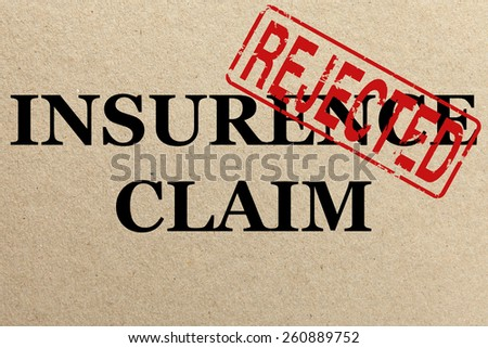 Paper texture with Rejected insurance claim - stock photo