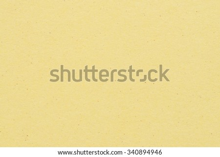 Paper texture - yellow kraft sheet background. - stock photo