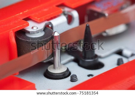 paper tractor mechanism recorder macro - stock photo