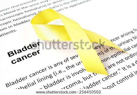 Paper with bladder cancer and yellow ribbon - stock photo