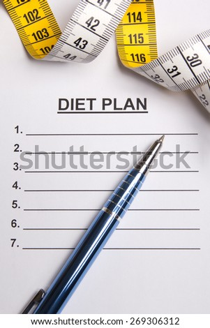 paper with blank diet plan, pen and yellow measure tape - stock photo