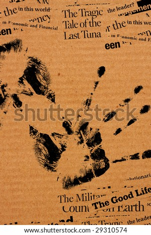 Paper with human hand print and abstract text - stock photo