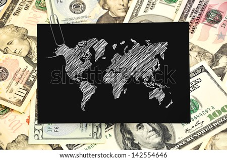 paper with map on background of dollars