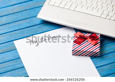paper with My Business inscription near notebook on wooden background