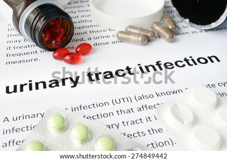 Paper with urinary tract infection and pills. Medical concept. - stock photo