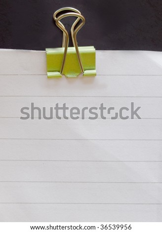 paper with yellow paperclip - stock photo
