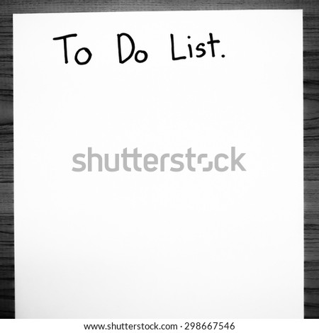 paper write to do list word on wood background black and white color tone style - stock photo