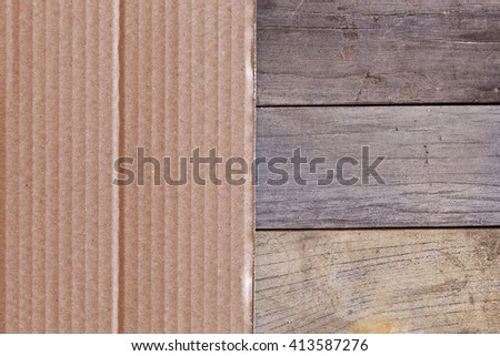 Paperboard on wooden planks in close-up. - stock photo