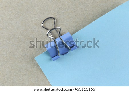 PaperClip action pin in blue paper note on Brown cardboard and can input text to it.