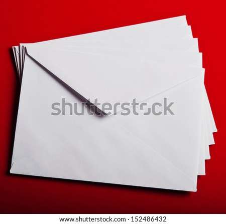 Papers envelope on red background