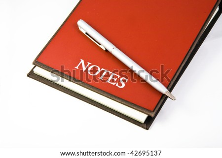 Papers for notes with a pen