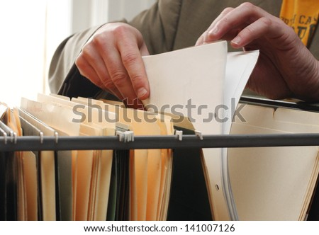 Paperwork in a filing cabinet - stock photo