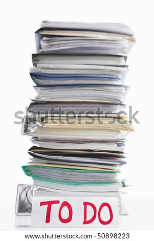 Paperwork to do concept with to do word in front of pile of paper. Selective focus - stock photo