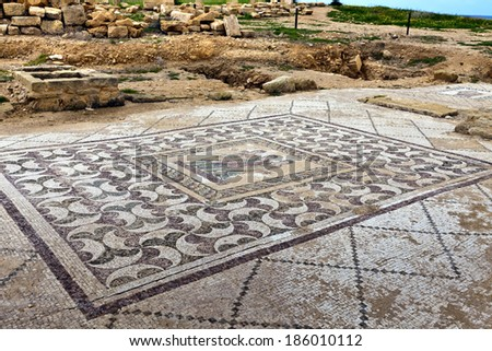 PAPHOS, CYPRUS - MARCH 6, 2014: Ancient mosaics at the Archaeological Helenistic and Roman site at Kato Paphos in Cyprus.