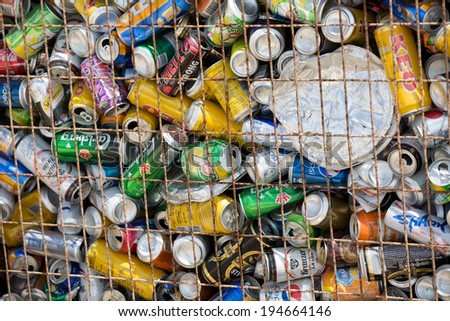 PAPHOS, CYPRUS - MAY 25, 2014: A lot of different empty aluminum cans in the garbage container on the sea resort line - stock photo