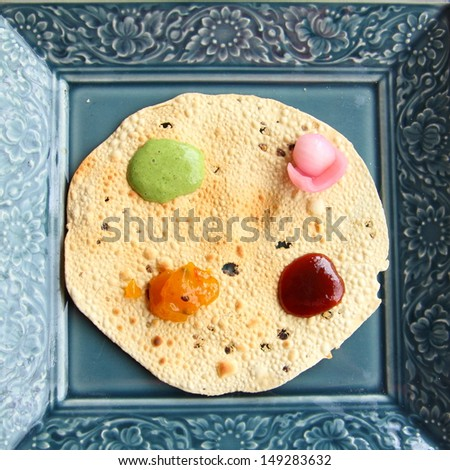 Pappadams with sauce - stock photo