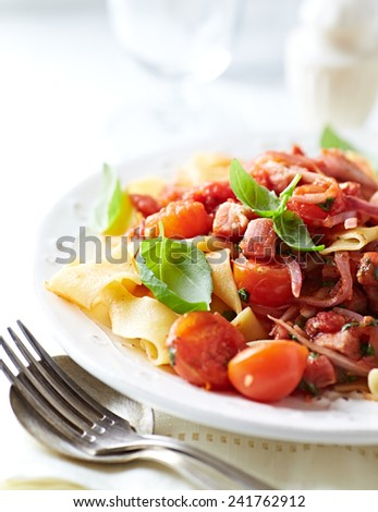 Pappardelle pasta with cherry tomatoes and pancetta - stock photo