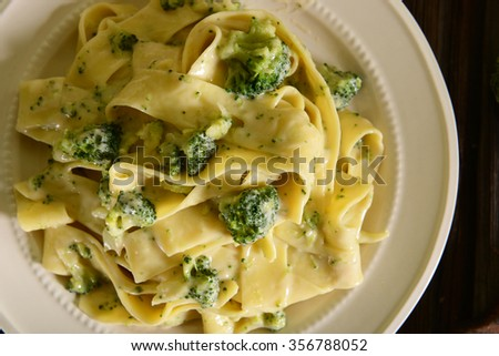 Pappardelle pasta with four cheese sauce and broccoli - stock photo