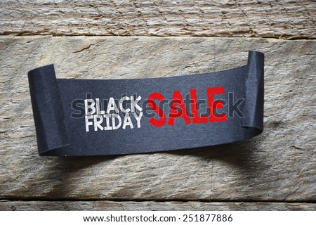 Papper with black friday sale. Black papper with black friday sale on wooden background - stock photo