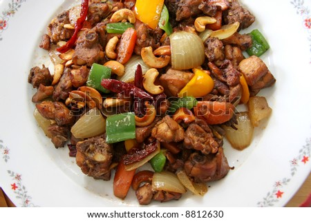 Paprika chicken with peppers and cashew nuts traditional chinese cuisine - stock photo