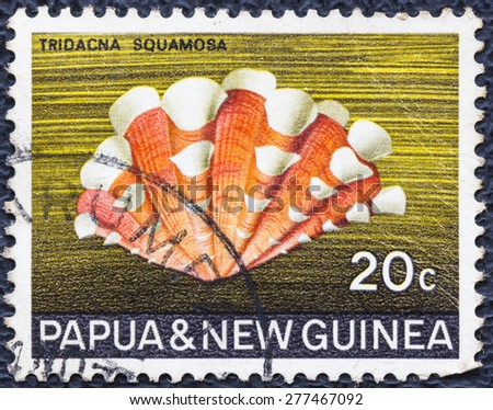 PAPUA NEW GUINEA - CIRCA 1969 : A stamp printed in Papua New Guinea shows Fluted giant clam [Tridacna squamosa] nice looking red and white shell , circa 1969 - stock photo