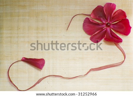 papyrus card for greeting red bow and flowers - stock photo