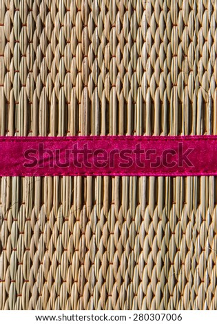 Papyrus mat close up background with pink strip. - stock photo