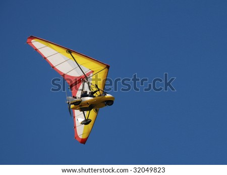 para glide/sail flying object on beautiful blue sky - stock photo